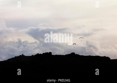 Two paragliders over Chinkwell Tor in Dartmoor National Park, Devon - Stock Image