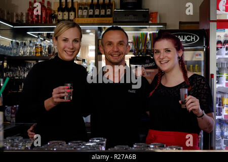 young bar staff taking a break from work in the dallas bar lenti zala county hungary - Stock Image