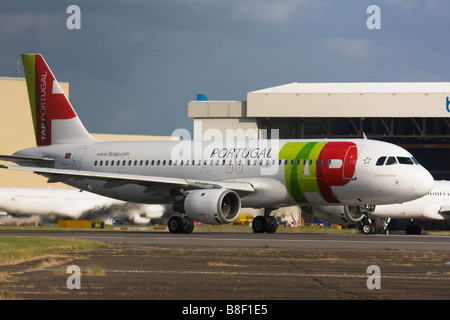 TAP Portugal Airbus A320-211 taxiing for departure at London Heathrow Airport, United Kingdom - Stock Image