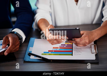 Team of people work together on company statistics. concept of teamwork and partnership. - Stock Image