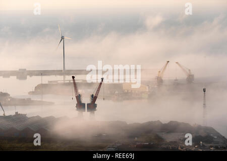 Swansea Docks Swansea Glamorgan Wales including Cranes and a Wind Turbine in the mist - Stock Image
