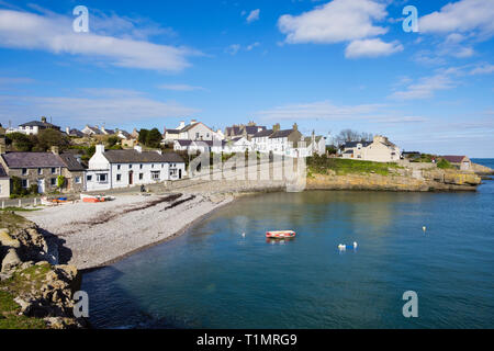 View across the beach to cottages on waterfront in village of Moelfre, Isle of Anglesey, Wales, UK, Britain - Stock Image