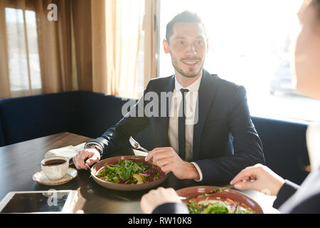 Talking to colleague by lunch - Stock Image