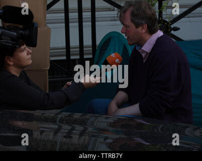 London, UK. 17th June 2019. Hunger striker Richard Ratcliffe in front of the Iranian embassy in London in protest of the detention of his wife Nazanin Zgahari in Iran over spying allegations. Richard interviewed by the German television broadcaster ZDF. Credit: Joe Kuis / Alamy - Stock Image