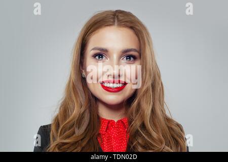 Smiling businesswoman on white background portrait - Stock Image