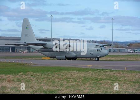 Swedish Lockheed C-130H Hercules Registration No 84006 846 makes a brief stopover at Inverness Dalcross Airport. - Stock Image