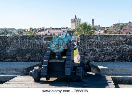 A cannon looks out over the city at the Castillo de San Marcos, a Spanish fortification at St. Augustine, Florida USA - Stock Image
