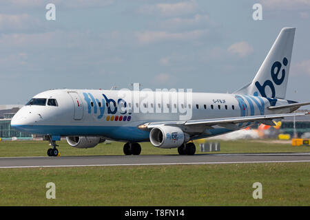 A Flybe Embraer ERJ-175 aircraft, registration G-FBJF, taking off from Manchester Airport, England. - Stock Image