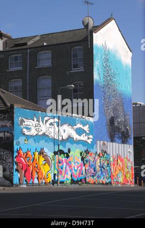 Graffiti on side of house near Brick Lane East End London - Stock Image