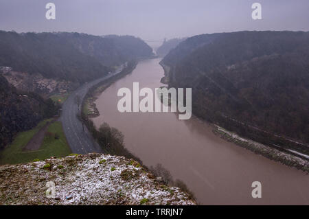 Snow falls over the Avon Gorge, Leigh Woods and iconic Clifton Suspension Bridge in Bristol. - Stock Image