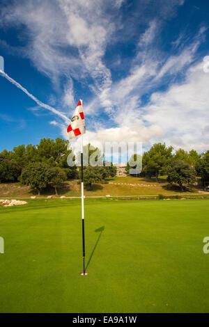 Golf flag with amazing sky - Stock Image