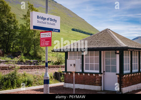 Station sign at the beautiful scenic Bridge of Orchy station on the West Highland train line, on a sunny day in June 2018 - Stock Image