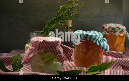 onions and carrots Pickled health food in bottles - Stock Image