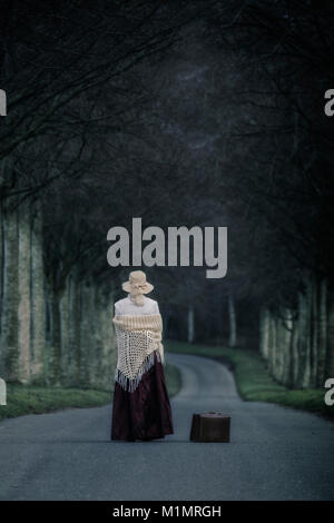 period lady on a beech alley - Stock Image