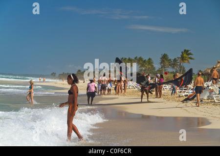 Kite surfer and teenager at Playa del Este, Santa Maria Del Mar, near Havanna Cuba - Stock Image