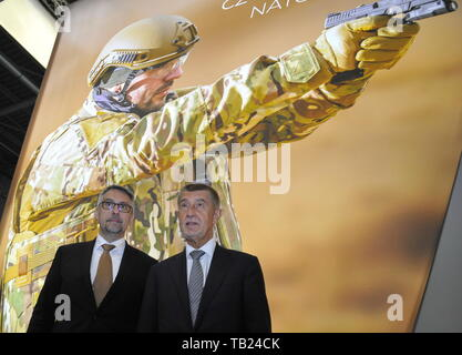 Brno, Czech Republic. 29th May, 2019. Czech Defence Minister Lubomir Metnar, left, and PM Andrej Babis visit the international trade fair of defence and security technology IDET, trade fair of security technology and services ISET and trade fair of firefighting technology PYROS in Brno, Czech Republic, May 29, 2019. Credit: Igor Zehl/CTK Photo/Alamy Live News - Stock Image