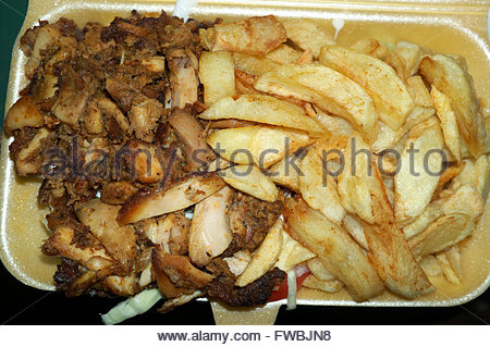 Chicken 'n' chips in a polystyrene tray. English takeaway food. - Stock Image