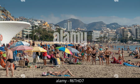 Benidorm, Costa Blanca, Spain, 6th December 2018. Sunbathers and swimmers enjoy temperatures in the high 20's Celsius today on Poniente and Levante beaches in Benidorm on the Costa Blanca coast. Credit: Mick Flynn/Alamy Live News - Stock Image