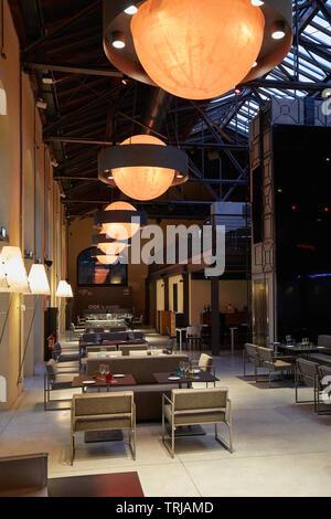 TURIN, ITALY - NOVEMBER 3, 2018: Ogr, Officine Grandi Riparazioni Snodo restaurant interior, evening in Turin, Italy. - Stock Image