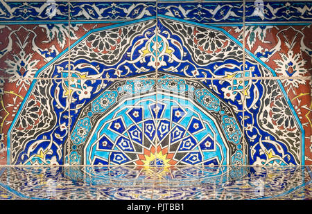 Part of fireplace from the royal era built of Turkish glazed ceramic tiles with floral ornamentations manufactured in Iznik - Stock Image