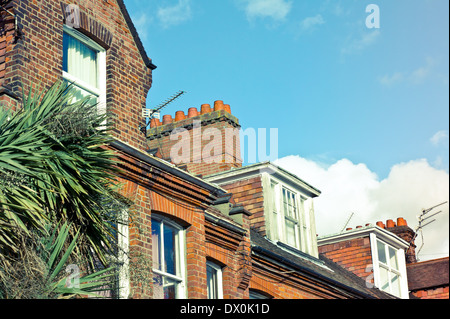 Row of victorian town houses in the UK with retro filter applied - Stock Image