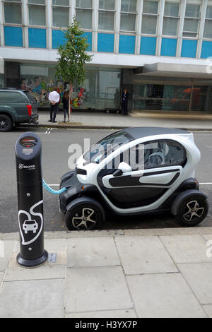 Electric car being charged at a road charging point, UK - Stock Image