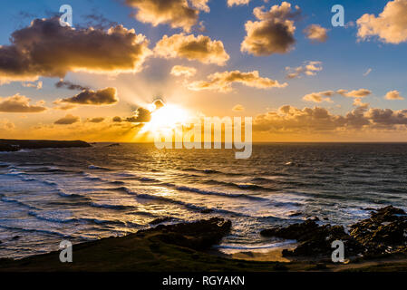 Sunset over stormy waves and surf at Fistral Beach, Newquay, Cornwall, UK - Stock Image