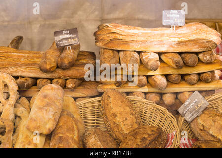 Baguette and other bread sold at Paris market. - Stock Image