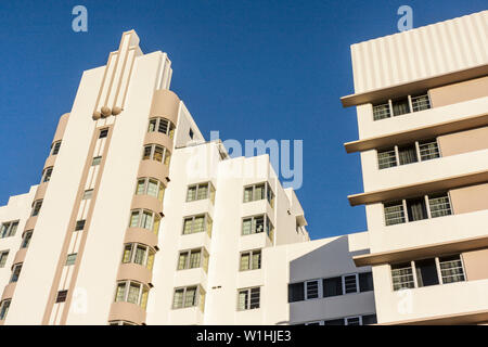 Miami Beach Florida Collins Avenue high-rise building Art Deco architecture rounded corner vertical line ziggurat design - Stock Image