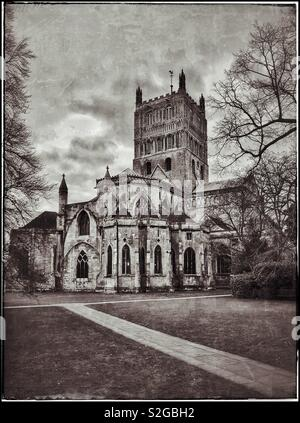 A retro and grunge effect image of Tewkesbury Abbey (Church of St. Mary the Virgin). This Parish Church is a fine example of Norman Architecture & is in Gloucestershire, England. Photo © COLIN HOSKINS - Stock Image