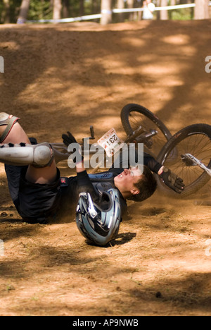 crashing mountain bike biker race racing at Chicksands Bedfordshire final Round of the National 4X Series at Beds Fat Trax - Stock Image