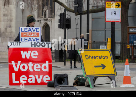 A pro-Brexiter protestor at the junction of Parliament Square in a week that Prime Minister Theresa May asks for MPs to back her Brexit deal, on 14th January 2019, in Westminster, London, England. - Stock Image