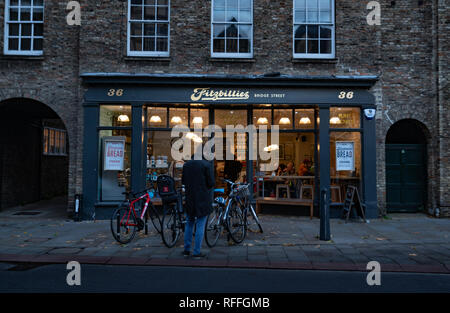A well known coffee shop in Cambridge town center at sunset - Stock Image