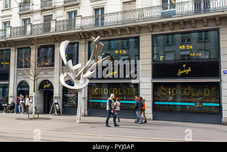 Zurich, Switzerland - March 2017: People walking in front of Confiserie Sprüngli, a Swiss luxury confectionery chocolat shop  manufacturer founded in  - Stock Image