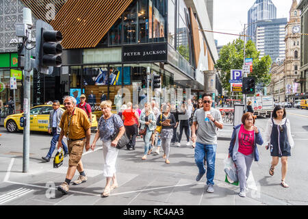 Melbourne, Australia - 21st February 2018: People crossing a street using a pelican crossing. Most streets have pedestrian crossings. - Stock Image