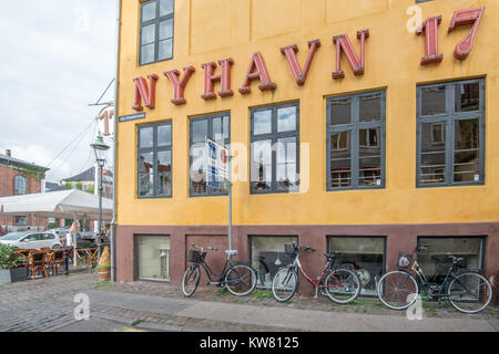Restaurant at Nyhavn, a 17th century harbor district in the center of Copenhagen and currently a popular waterfront - Stock Image