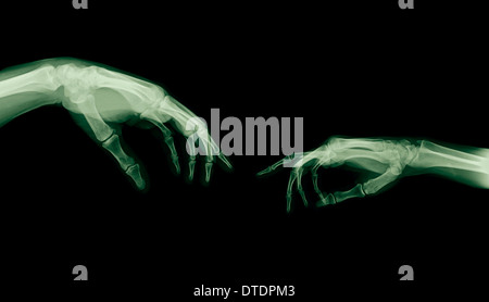 The Creation of Adam (Michelangelo) two hands under x-ray - Stock Image