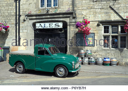 An original 1969 built Morris Minor pick-up truck, outside a Cotswold pub in Stroud, Gloucestershire, UK. - Stock Image