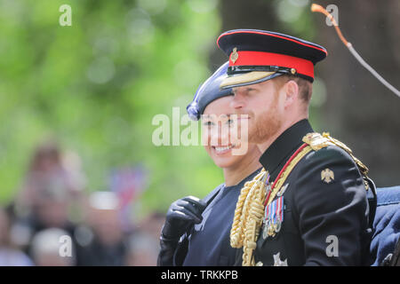 London, UK. 08th June, 2019. HRH Prince Harry, Duke of Sussex, HRH Meghan, Duchess of Sussex, smile at the crowds along The Mall, from their open top carriage, Trooping the Colour, The Queen's Birthday Parade, London UK Credit: amanda rose/Alamy Live News Credit: amanda rose/Alamy Live News - Stock Image