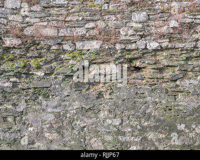 Old stone wall in a poor state. - Stock Image