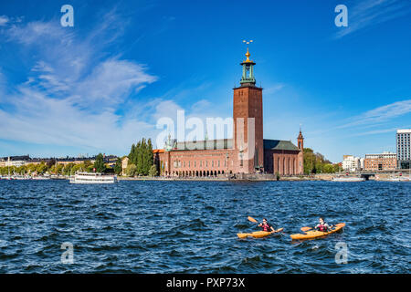 16 September 2018: Stockholm, Sweden - The City Hall, location of the Nobel Banquet, and two kayaks in the water. - Stock Image