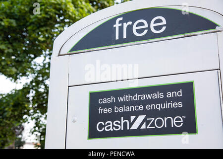 A sign indicating free cash withdrawls on a converted telephone box in a city centre street Preston Lancashire June 2018 - Stock Image