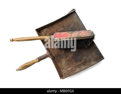 Vintage cleaning rusty dustpen and brush, isolated on white background - Stock Image