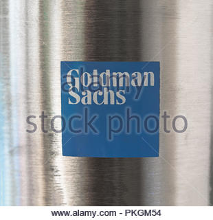 Blue logo of Goldman Sachs on a metallic convex surface. - Stock Image