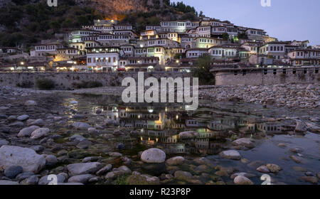 Views of the city of thousand windows a Unesco world heritage site reflecting in Osum river at sunset - Stock Image