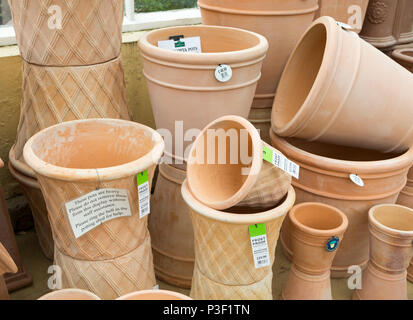 Display of terracotta pots on sale, The Walled garden plant nursery, Benhall, Suffolk, England, UK - Stock Image