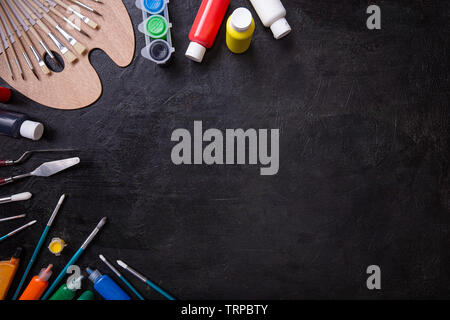 School supplies stationery equipment on chalkboard with copy space - Stock Image