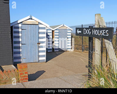 Dog houses by the beach access on the Norfolk coast at Winterton-on-Sea, Norfolk, England, United Kingdom, Europe. - Stock Image