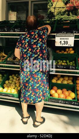 Woman shopping for fruit and vegetables - Stock Image