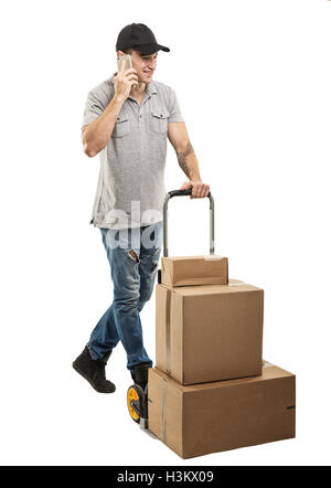 During a call - Courier hand truck boxes and packages - Stock Image